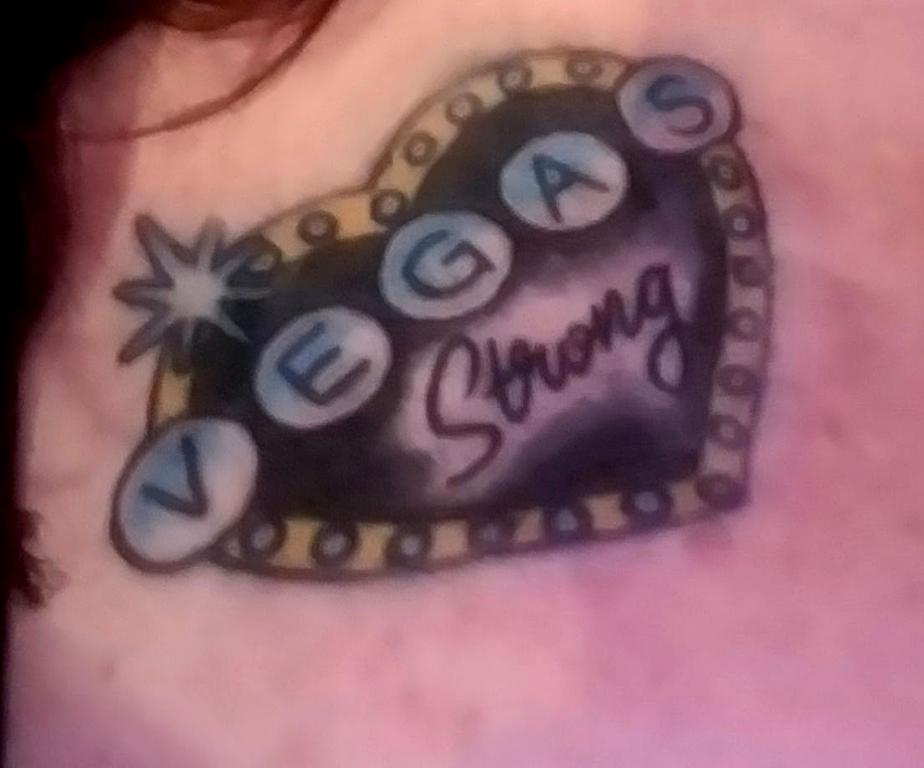 Been away for too long...but vegas girl is SAFE-vegas-tat.jpg