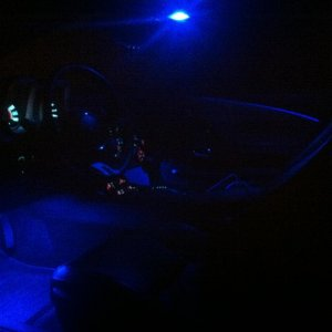 Blue LED in footwells, cup holders, changes dome light, Changed door led to same color